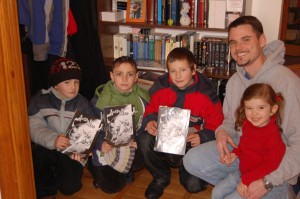 The boys who came to carol at our house show off their new copies of Good and Evil.