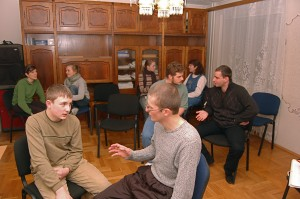 During English Club, everyone splits up into groups to practice conversational skills.