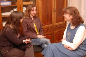 Denise talking with some girls who just began attending recently.