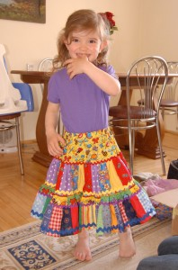 Abby tries on a new skirt that Baba (her grandma) made for her.