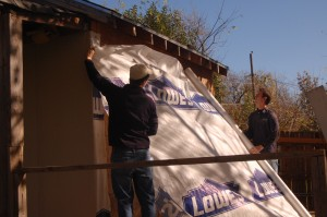 Tristan Nugent (left) and Ross Atherton (right) installed new siding on our storage building in the back yard.