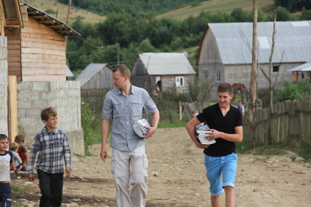 Nathan Day and Adam (a young man from the east of Ukraine) distribute Good and Evil books in a gypsy village in the Carpathians.