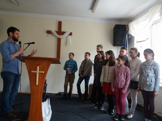 The class receives three challenges in front of the congregation on our first day.
